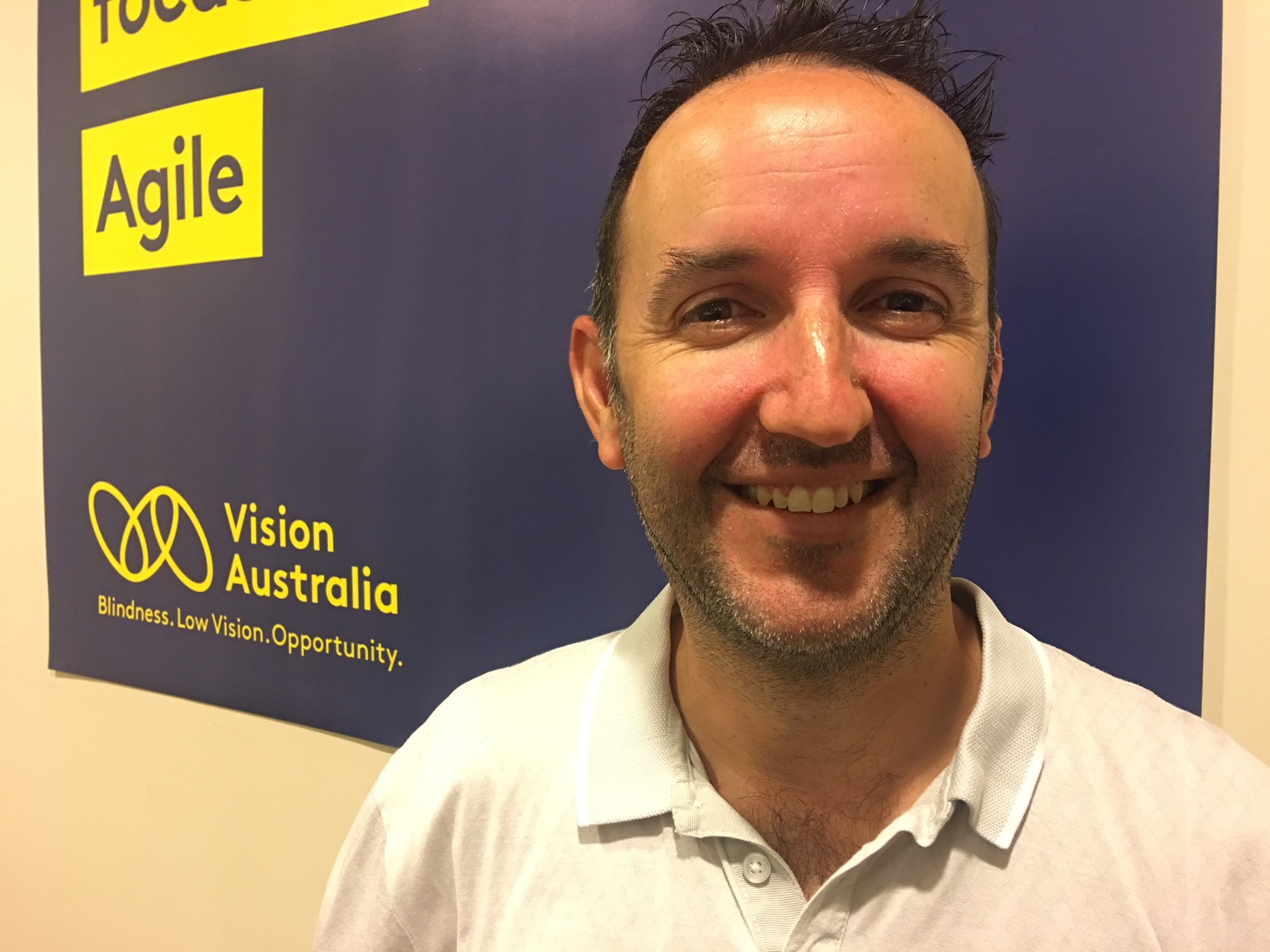 Luke Price at Vision Australia office