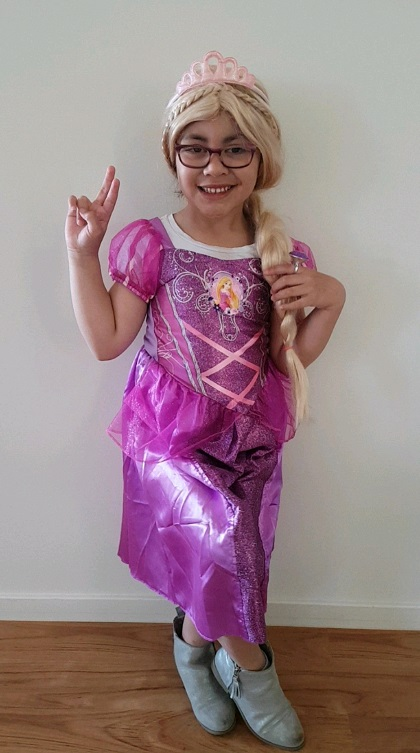 Image shows Paisley dressed as Rapunzel