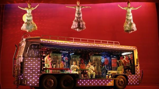 Set of Priscilla Queen of the Desert showing a bus and dancing characters involved in the show